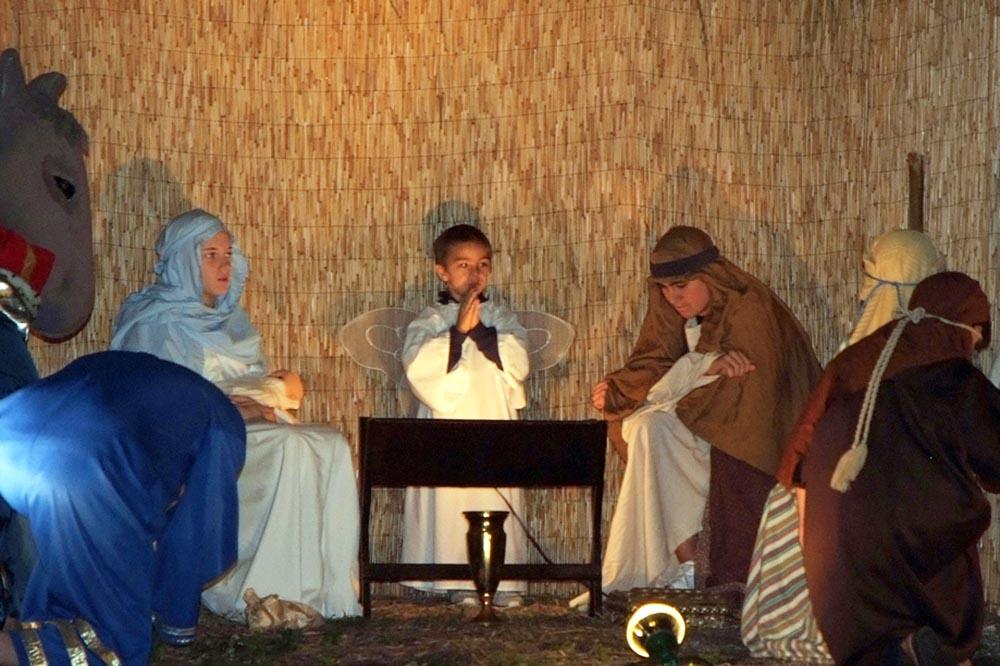 Children in costumes performing birth of Jesus