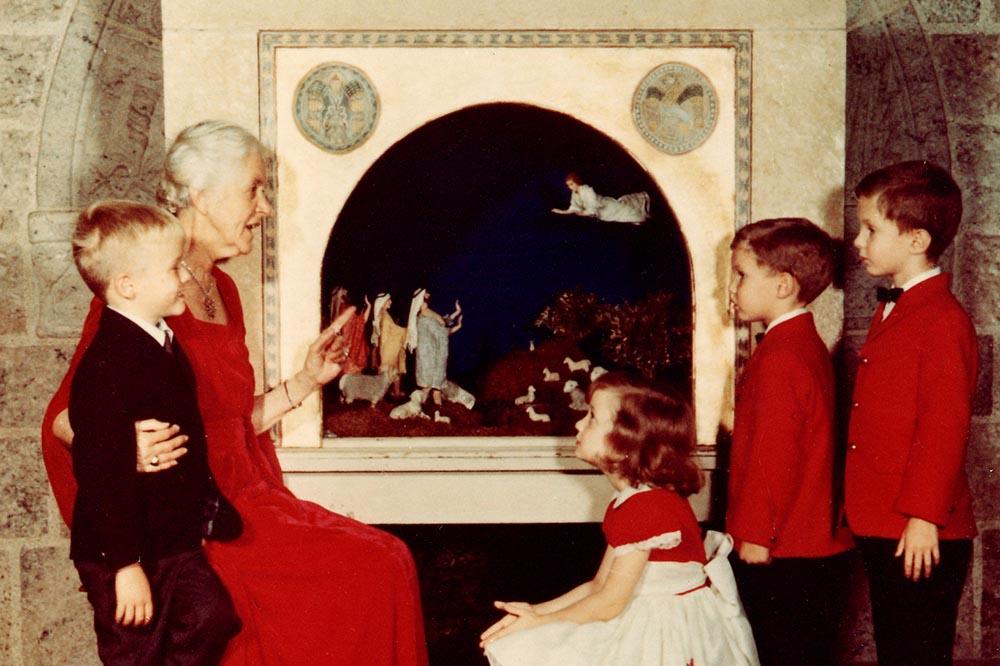 Woman explaining nativity scene to children